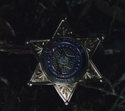 Chief Judd Crawford badge with blood