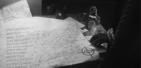 Cyclops map of towns they planned to target to brainwash in S1 E6