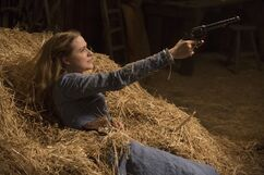 Dolores holding the gun