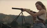 Dolores with rifle on horseback