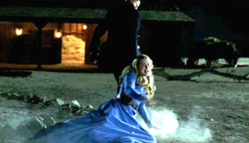 Dolores dragged by man in black