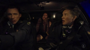 Sheena transforms into a werewolf in the back of the police car