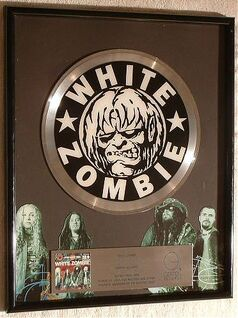 White-zombie-astro-creep-2000-songs-of-love-destruction-and-double-platinum-record-award-for-the-sale-of-more-that-2-million-records-sold-presented-to-white-zombie be23ed8e8a30b258f0220da0411e5404