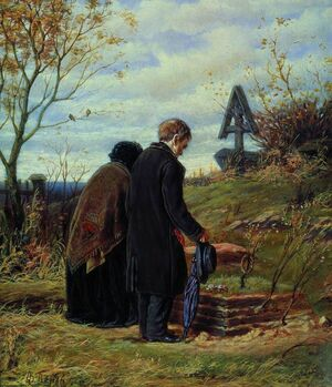 Старики-родители на могиле сына