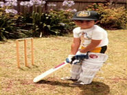 YoungSamPlayingCricket