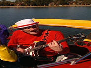 MurrayPlayingMatonGuitarintheBigRedBoat