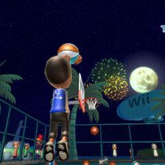 Playing basketball at night.