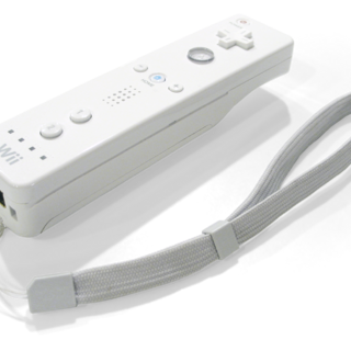 A Wii Remote without its jacket.