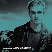 "A blueish colored portrait of a young blonde man who is wearing a black shirt and a black leather jacket. In the left bottom corner is written his name ""Justin Timberlake"" and the track's title 'Cry Me a River' in white letters."