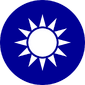 A blue circular emblem on which sits a white sun composed of a circle surrounded by 12 rays.
