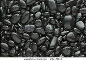 Stock-photo--black-pebble-background-black-pebble-pattern-204170812