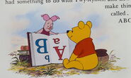 Piglet and Pooh Bear are both reading and learning a book about ABC's that's upside down