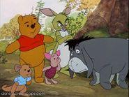 Pooh and his friends looking at Tigger