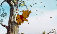 Winnie the Pooh got his bottom stuck in the honey tree