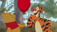 Tigger now has the red balloon as his sidekick