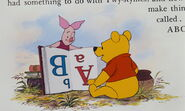 Winnie the Pooh and Piglet are learning and reading a book about ABC's that's upside down