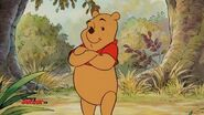 Winnie the Pooh folds his arms