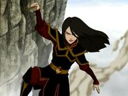 Azula hangs from cliff