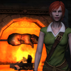 Shani standing by the fire inside the <a href=