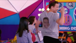 Cam showing face on shirt to Jessie