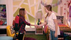 Andi Samantha hand shake