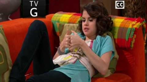 Selena Gomez.playing thumb war