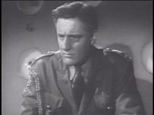 Henry Beckman as Commander Paul Richards in Flash Gordon