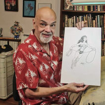 George Perez holding WW drawing