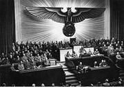220px-Bundesarchiv Bild 183-1987-0703-507, Berlin, Reichstagssitzung, Rede Adolf Hitler
