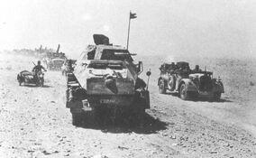 Vehicles of Panzerjäger-Abteilung 39 moving through the desert, 1942
