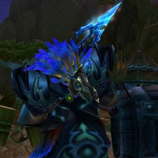 Gracz pod uzbrojoną postacią arakkoa.