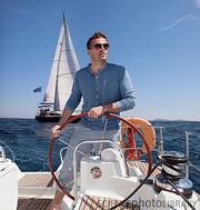 F0040130-Man steering yacht-SPL