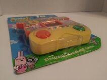 Wubbzy Electtronic Handheld Game Package - Front, Bottom Left