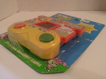 Wubbzy Electtronic Handheld Game Package - Front, Bottom Right