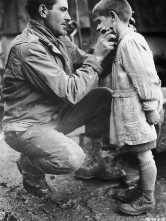 File:American-soldier-walton-trohon-cleaning-the-face-of-a-young-french-orphan-during-wwii.jpg