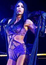 Billie Kay posing WrestleMania 32 Axxess