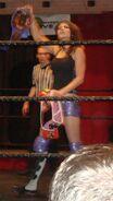 Britani Knight as Triple Crown Champion