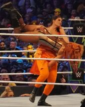 480px-Kavita Devi wrestling Becky Lynch at WrestleMania 34
