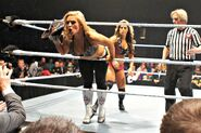 800px-Kaitlyn vs Natalya live event 2012 (cropped)