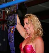 Laurel Van Ness with Queens of Combat tag team belt