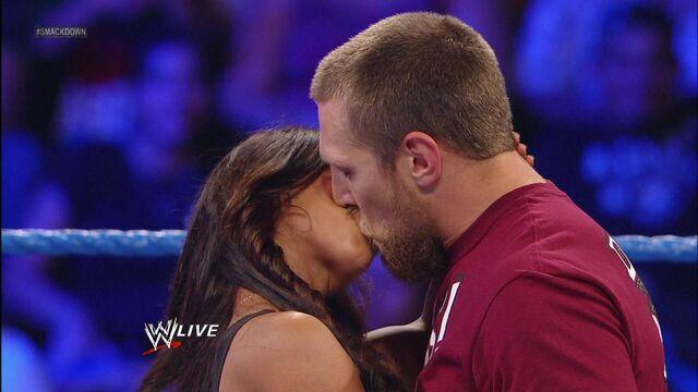 File:Aj lee kissing Daniel Bryan .jpg