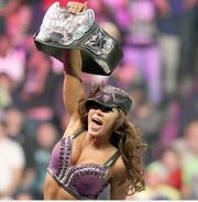 Mickie James holding the title high