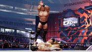 Stone Cold elbow drops CM Punk