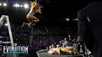 Becky Lynch's ladder leap sends Charlotte Flair through announce table- WWE Evolution 2018