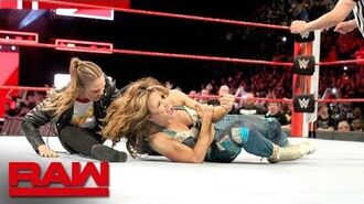 Ronda Rousey locks Mickie James in an armbar during the main event- Raw, April 23, 2018