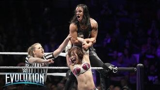 Kairi Sane launches Shayna Baszler onto NXT Superstars seated in the front row- WWE Evolution 2018