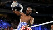 Kofi-Kingston holding the SmackDown Tag Team Champion