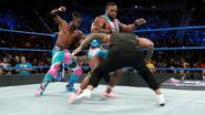 Big-E and Kingston attacking The-Usos
