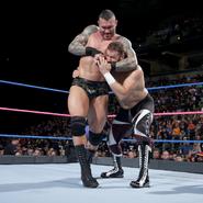 Orton putting Zayn in a headlock