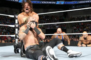 Styles puts Amore in a headlock